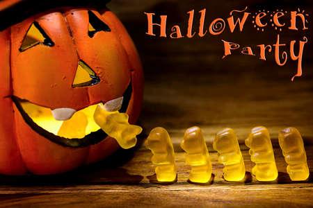 gummy bear: halloween pumpkin eating a row of gummy bear and halloween party written