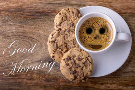 cup of coffee with chocolate cookies on wood and good morning written Stok Fotoğraf
