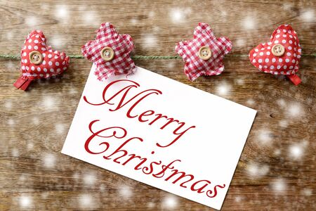 clothespins: merry christmas on wood with clothespins Stock Photo