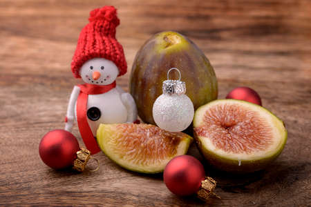 snowman wood: fig on wood with snowman and christmas balls