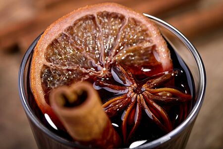 cinnamon stick: mulled wine made with orange, cinnamon stick and star anise in a glass Stock Photo