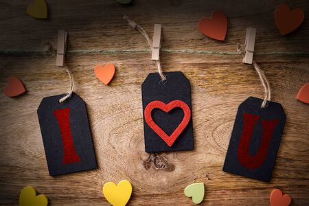 clothespins: blackboard and clothespins on wood with colored heart and i love you written