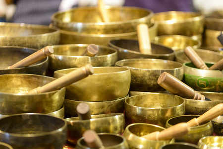 singing bowls: tibetan singing bowls of various sizes in a market