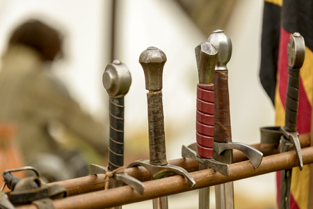 chivalry: handles of swords to a medieval reenactment