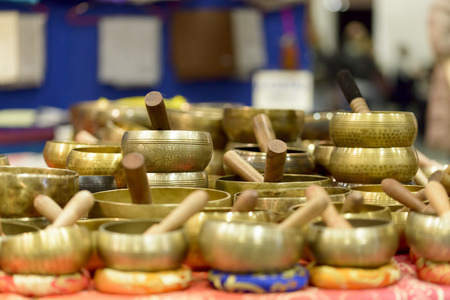 singing bowls: Tibetan singing bowls of various sizes in a market Stock Photo