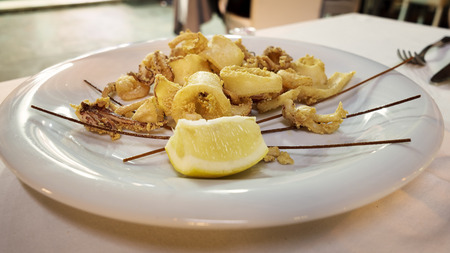 shrimp, squid and octopus fried and slice of lemon Stock Photo
