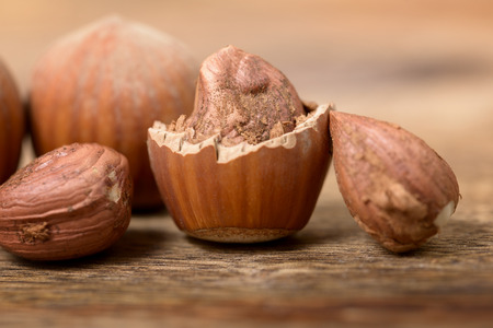 nutshell: macro and hazelnut nutshell on wooden table Stock Photo