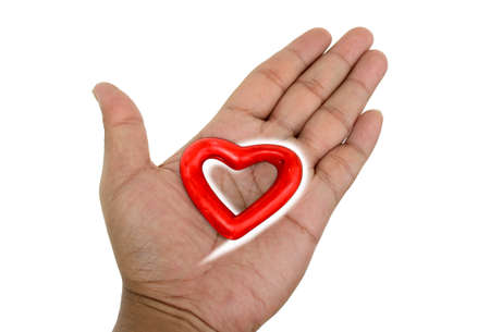 red heart on hand isolate Stock Photo