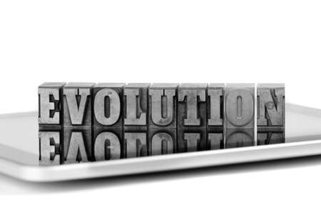 plumb: The word EVOLUTION in old plumb letters on a tablet computer