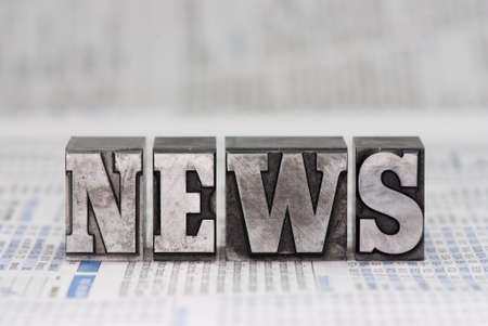 plumb: The word news in old plumb letters, which were used to print newspapers in the past. Stock Photo
