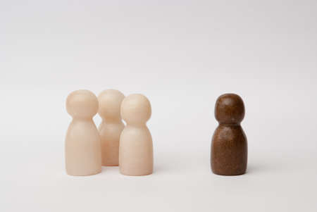seperated: White and brown figures in front of a white background Stock Photo
