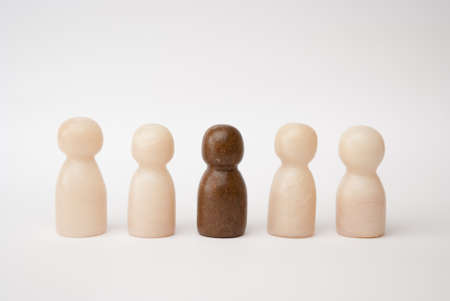 seperation: White and brown figures in front of a white background Stock Photo