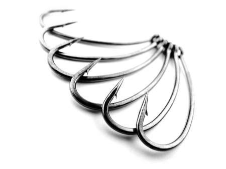 Steel fishing hooks on a white background. Soft focus. Stock Photo