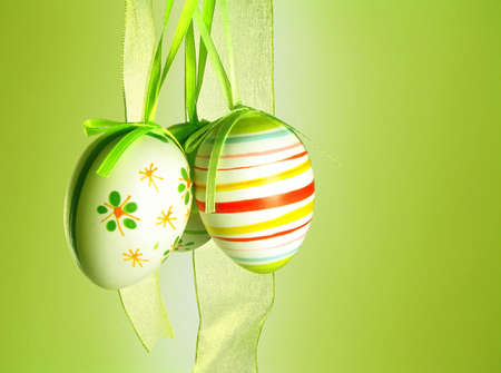 Easter eggs with a ribbon on a green background photo