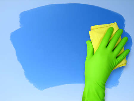 blue gloves: Hand in rubber glove wiping cloth surface Stock Photo