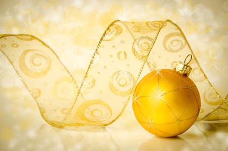 Golden Christmas ball and ribbon.