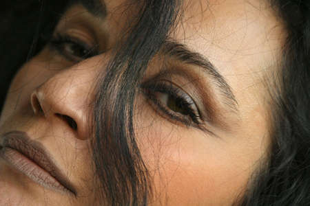 close up of womans face with hair in front