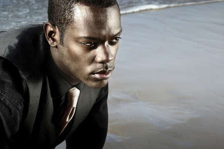 african american man in suit on the ocean Stock Photo - 3622531