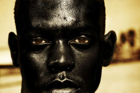 water feature: close up of wet African mans face  Stock Photo