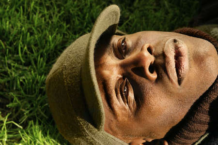 close-up of African-American man laying on grass photo