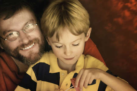 portrait of father and son with red background photo