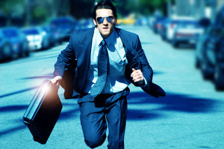 escape: young business man running with briefcase