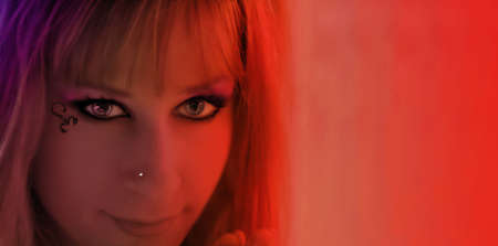 close-up of pretty girl in red neon light at night