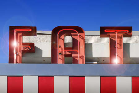 american midwest: red and white fat sign against blue sky