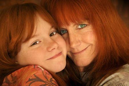 red headed mother and daughter hugging  Reklamní fotografie
