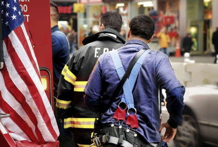 fire fighters with an ambulance and an American flag in chaotic New York City photo