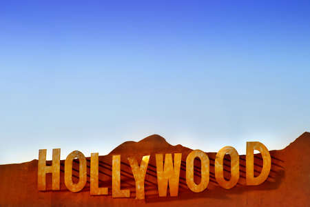 the Hollywood sign cast in metal against blue sky photo
