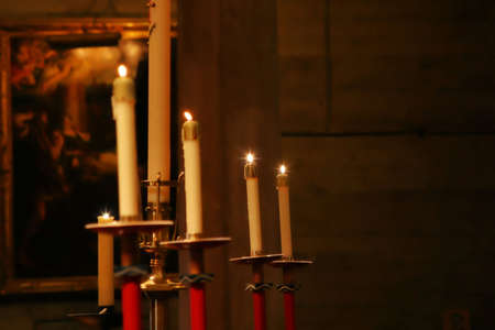 candle holder: Lit candles displayed in church Editorial
