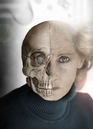 Portrait of woman with half of face as skull photo