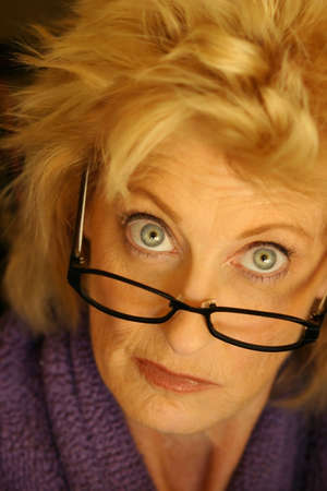 Portrait of woman with glasses giving dissaproving look photo