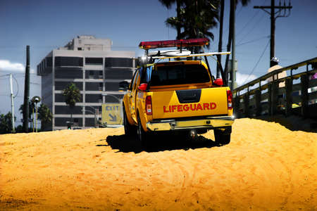 gaurd: Bright colorful photo of life guard truck on the beach Stock Photo