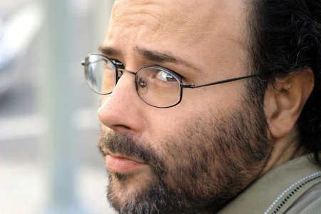 Portrait of a serious bearded man with glasses photo