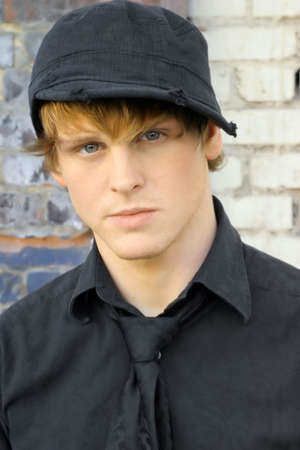 Close-up portrait of young man in black shirt and hat Stock Photo - 3817435