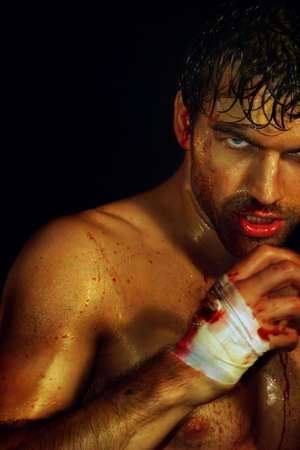 Gritty portrait of a sexy young, bloody boxer Stock Photo - 3829866