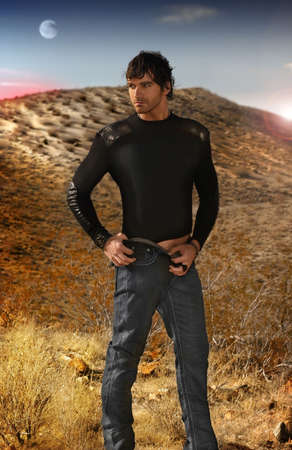 Full body fashion portrait of young good looking male model against an otherworldy background