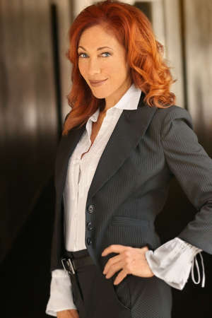 older women: Portrait of a red-headed attractive businesswoman smiling
