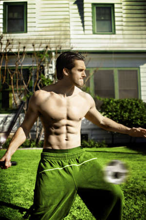 Shirtless athletic guy working out Stock Photo - 21542437