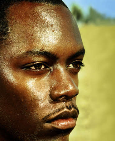 man profile: Close-up portrait of an African male against desert background