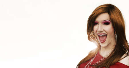 drag queen: Portrait of a drag artist laughing against white background