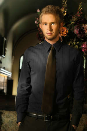 Portrait of young male model wearing formal attire in upscale luxurious surroundings Stock Photo - 4063711