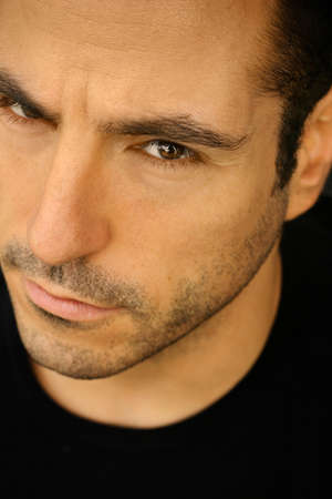 Extreme tight close-up portrait of good looking male model in natural light