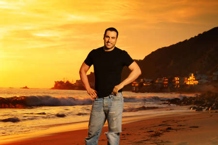 Good looking man on the beach at sunset in golden light Stock Photo - 4189754