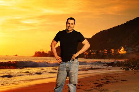 Good looking man on the beach at sunset in golden light Stock Photo - 4189754
