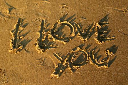 """""""Te Amo"""", escrita en la arena Foto de archivo - 4307293"""