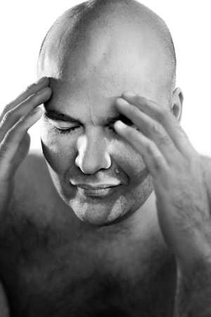 insanity: Fine art black and white portrait of a bald man with hands on face against white background