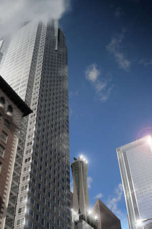Stylized architectural cityscape of office buildings with several reflective flares (shallow depth of field) Stok Fotoğraf
